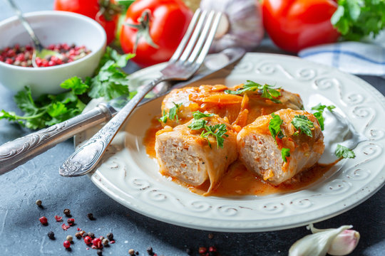 Cabbage rolls with minced meat and sour cream.