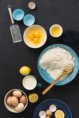 Fototapete - Baking ingredients cooking homemade muffins or lemon cookies. Bakery background top view