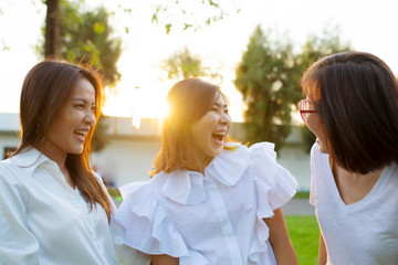 three asian woman relaxation outdoor with happiness face