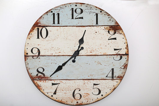 Old wooden wall clock on white background