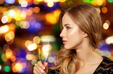 0d7229e28028 celebration, party and holidays concept - woman with glass of non-alcoholic  champagne at