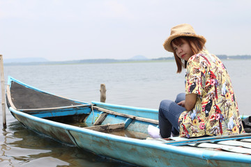 view of the young woman wear hat in relax outside on the boat