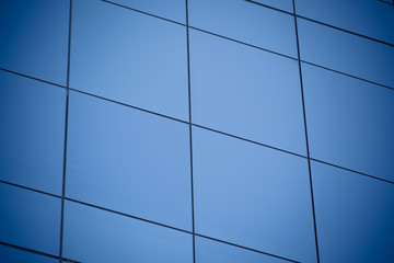 Modern office building with blue glass windows Wall mural