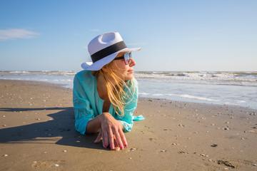 beautiful woman lying on the shore