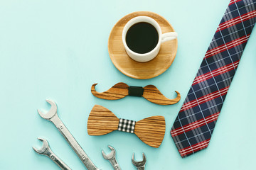 top view photo of gift box, necktie and cup of coffee. Father's day concept