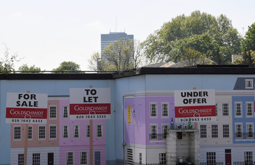 An estate agent property advertisment is seen painted on a wall in London