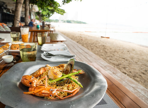 Paella sea food beside the sea