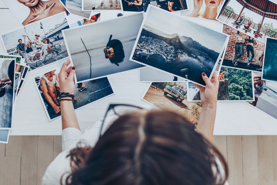 Photographer looking at prints in studio