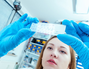 Girl lab technician at the clinic's microbiology laboratory
