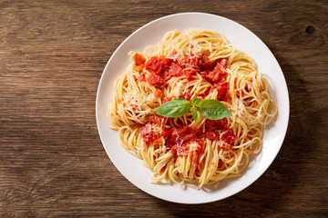 plate of pasta with tomato sauce, top view