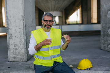 construction worker having lunch break on site