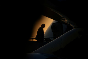 U.S. President Trump boards Air Force One on his way to Washington