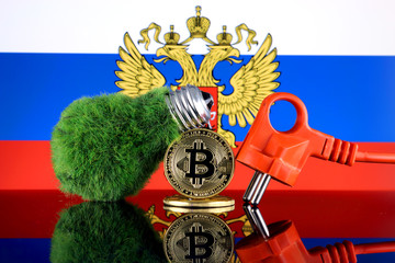 Bitcoin (BTC), green renewable energy concept, and Russia Flag. Electricity prices, energy saving in the cryptocurrency mining business.