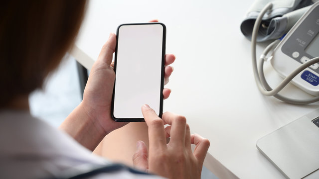 Smartphone with Blank screen in the hand of female doctor