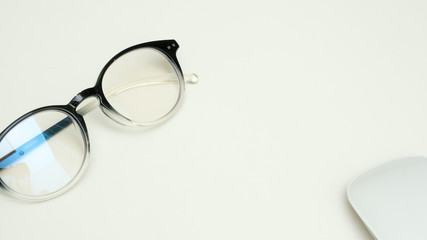 Wall Mural - glasses with mouse on white background