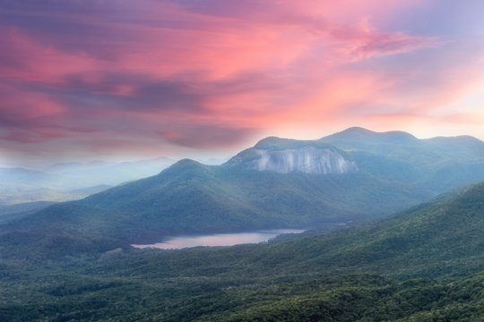 Soft, dreamy sunset view from a Caesars head overlook in South Carolina on a Table rock mountain and reflections in a lake