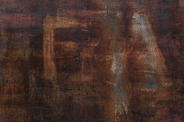 Rusty background. Old rusty metal sheet. Red rusted wall of the garage. Brown background. Grunge texture. The inscription is visible FA