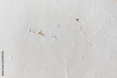 Old paper texture  Dirty and yellowed old paper texture for