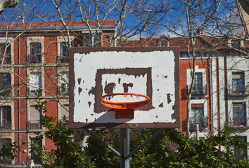 basketball ground in front of an apartment block