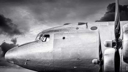 cockpit of an historical aircraft against an dramatic sky