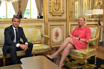 """IBM CEO Ginni Rometty poses for a photo with French President Emmanuel Macron during the """"Tech For Good"""" summit in Paris"""