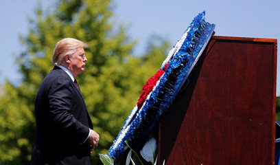 President Trump stands in front of wreath at National Peace Officers Memorial Service on Capitol Hill in Washington