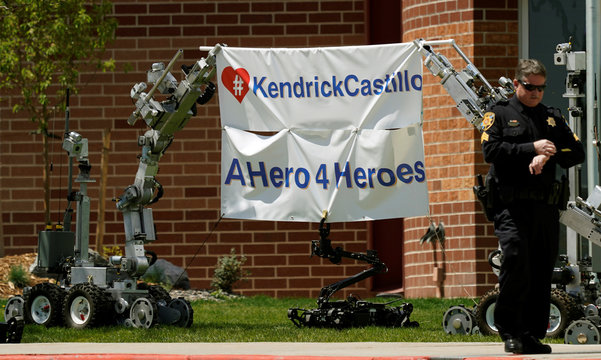 Police department robots hold up a banner outside the memorial service of the shooting victim Kendrick Castillo of the Science, Technology, Engineering and Math (STEM) School in Highlands Ranch