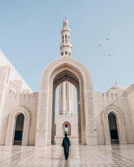 person standing in the middle of mosque