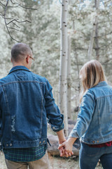 woman and man holding hands together