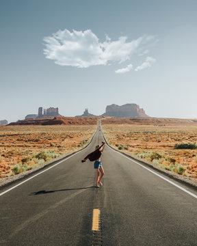 woman in gray asphalt road