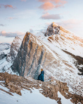 woman standing on mountain peek
