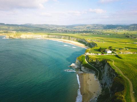 shore meets grassy cliffs