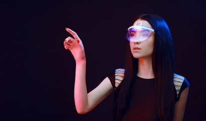 Wall Mural - Beautiful woman in futuristic 3d glasses with virtual projection over dark background. Girl in glasses of virtual reality. Augmented reality, science, future technology, robots and people concept. VR.