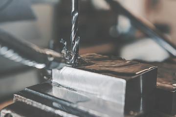 Metal drilling closeup. Metal workshop.