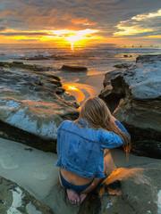 beautiful woman on the coast at sunset