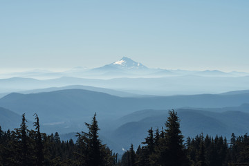 Aluminium Prints Mount Jefferson and Three Sisters seen from Mount Hood with blue misty silhouettes of mountains.