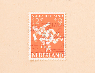 THE NETHERLANDS 1960: A stamp printed in the Netherlands shows children playing, circa 1960