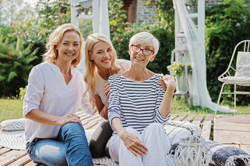 Three happy women smiling, togetherness