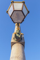 Old street lamp with a bronze horse for lighting a bridge in the city of St. Petersburg, Russia