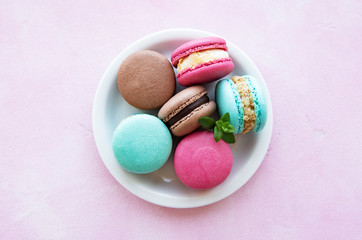 Colorful macaroons and mint