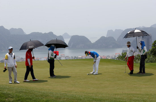 South Korean businessman Kim Yeong Jin putts for par on the 12th green at the FLC golf course in Ha Long Bay