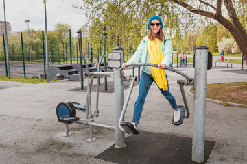 Woman have fun and exercising at outdoors gym playground equipment