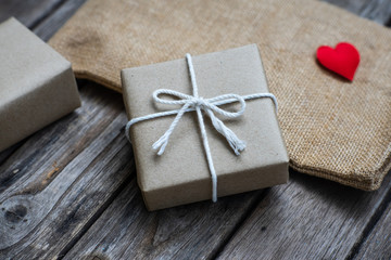 Brown paper gift box tie with rope on old wooden background Wall mural