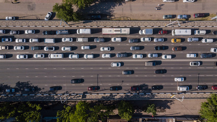 Top down aerial view of urban city traffic jam rush hour highway.