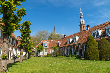 Old almshouses around a small, public courtyard (Sint Anthony Gasthuis) in the Dutch city of Groningen. Netherlands
