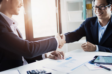 business cooperation and confident partner concept, business people shake hands with customer