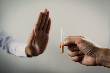 World No Tobacco Day in May, stop smoking concept, young man against cigarette