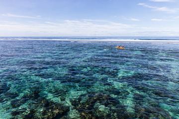 Watersport kayak in clear pacific ocean water in the reef on a tropical island