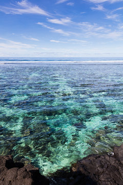 Clear blue pacific ocean water in the reef on a tropical island