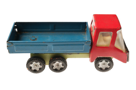 Old toy truck on white